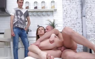 Teen naked babe Stasya Stoune riding his fat massive dick in the kitchen